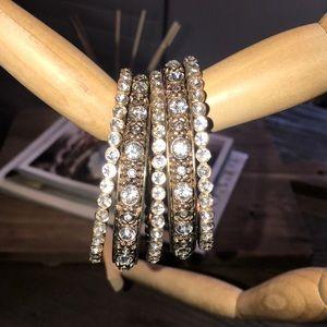 Gold and jeweled bracelets